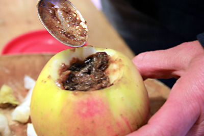 Filling Bramley Apples with mincemeat